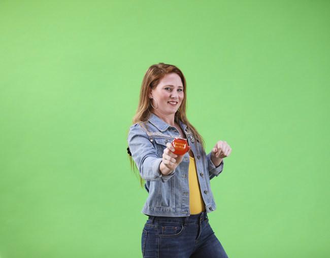 "Jackie Heath poses with Peachballz BuzzBallz during the ""Shake It"" video shoot. Photo courtesy of BuzzBallz, LLC/Southern Champion. Photos shot by Clay Hayner."