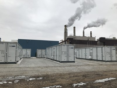 """Leading Indiana utility uses FlexGen lithium-ion battery energy storage for """"black start"""" capability to jump start two 77 MW natural gas turbines in case the power goes out. The batteries are housed inside the containers pictured here. FlexGen is headquartered in Durham, N.C."""