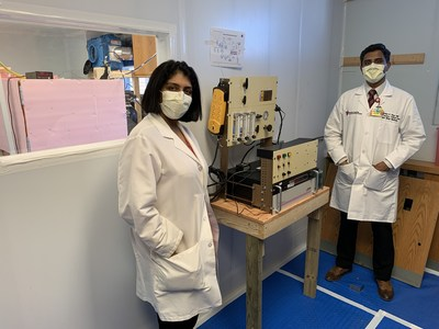 Doctors Amrita John and Shine Raju at UH Cleveland Medical Center with the device that decontaminates masks using atomic oxygen. Courtesy: University Hospitals