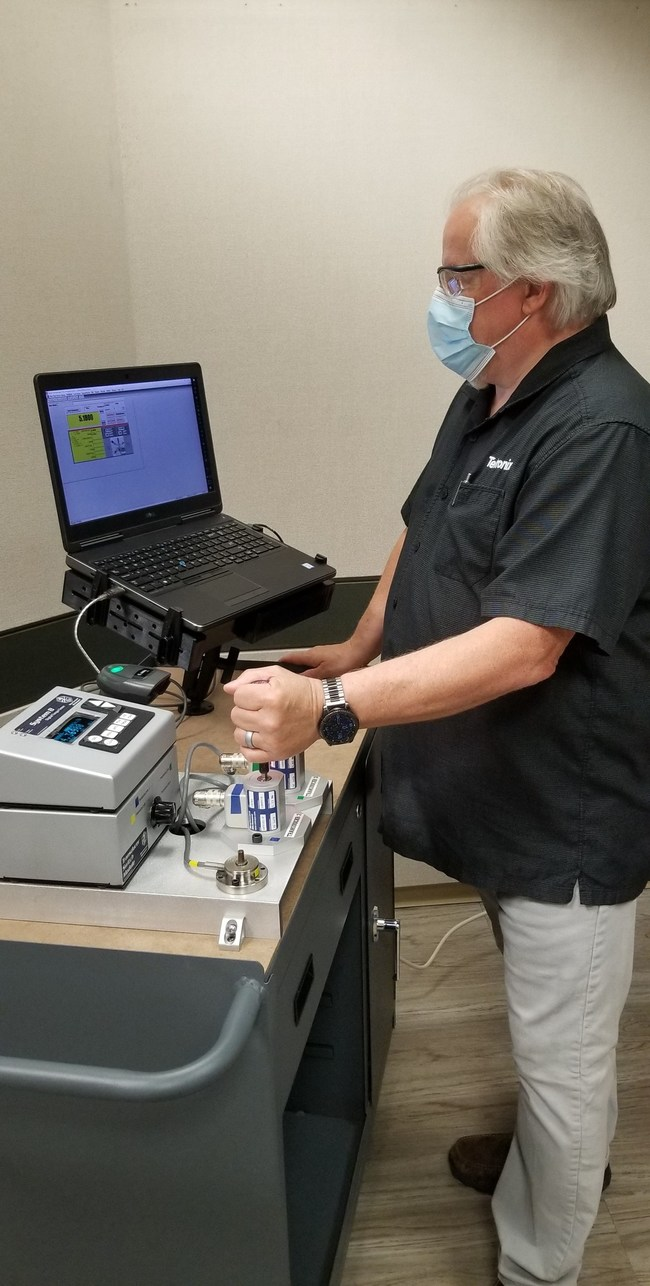 Robin Reynolds, Senior Calibration Technician at Tektronix, managing the torque screwdriver tools involved in ventilator production.