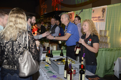 Pictured: Local Lawrenceburg, KY winery Lover's Leap Vineyards handing out samples to thirsty attendees. All proceeds raised go directly to three local homeless shelters, a tradition that reached the $2 million mark this past year.