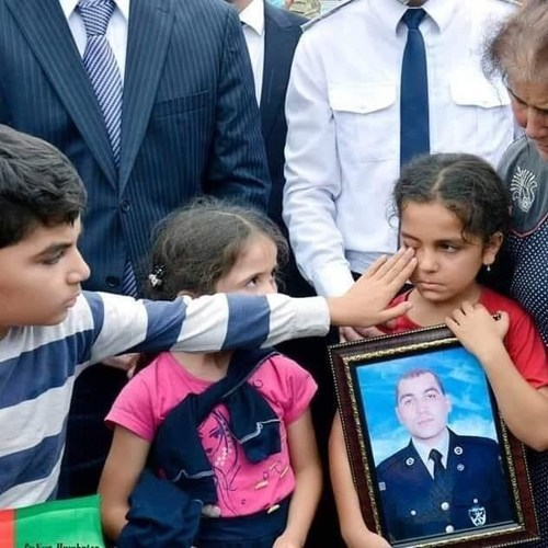 Children at the funeral of their father, Vugar Sadigov, killed while repelling Armenia's attack on July 12