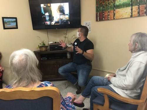 Toby Stigdon, Certified Dementia Practitioner, shares Video Visits with residents at Columbus Transitional Care