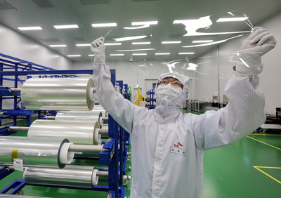 An employee of SK IE Technology is checking the FCW products soon to be supplied to a global smartphone manufacturer at FCW factory in Jeungpyeong, North Chungcheong Province, South Korea.