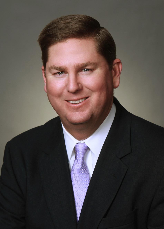 Curtis L. Dinan