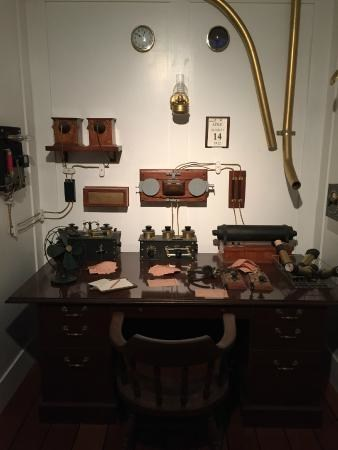 Caption: This image is a room recreation of Titanic's Marconi Room which is on display at Titanic: The Artifact Exhibition in Orlando. This is where wireless operator, Jack Phillips sent distress messages to other ships in the area alerting them for help once Titanic hit the iceberg on April 14, 1912.