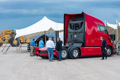 Guests of the Nikola groundbreaking ceremony inspect the Nikola Two zero-emission class 8 commercial truck that will be built on the site.