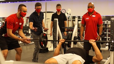 ER physicians Dr. Christopher Hicks and Dr. Andrew Petrosoniak oversee an in-club simulation to 'crash test' COVID-19 protocols for GoodLife Fitness. (CNW Group/Advanced Performance Healthcare Design)