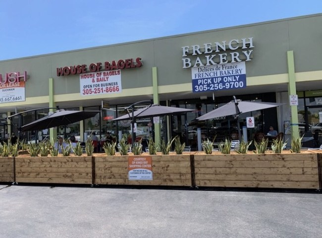Landlord provides tenants outdoor seating in parking lot to help them stay in business.