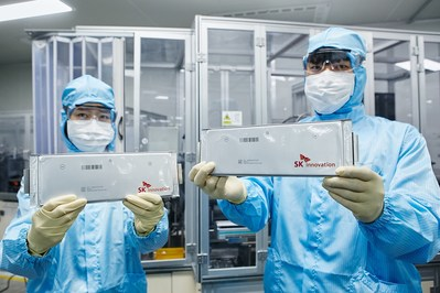SK innovation researchers hold up EV battery cells. The company will be working with Professor John Goodenough, a 2019 Nobel laureate in chemistry, to advance battery technology.