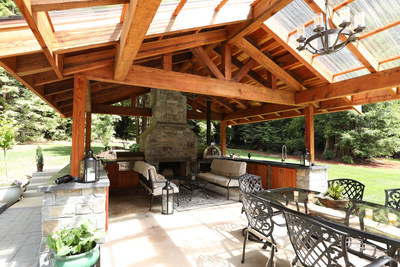 With separate sections for eating and dining, and a clear, corrugated plastic roof over part of the space, the homeowners can enjoy ample natural light, even on rainy days.