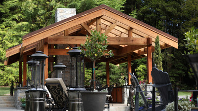 """Redwood timbers, including 6'x6"""", 6""""x10"""", and 6""""x12"""" dimensions, provide the structural elements of the pergola, achieving the mass and strength properties required for the construction."""