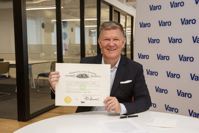 CEO and Founder Colin Walsh signs OCC charter, officially making Varo the first consumer fintech to become a national bank, July 31, 2020 - photo courtesy of Varo Money