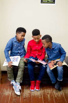 Boys reading at a barbershop affiliated with Barbershop Books