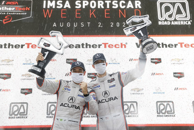 Helio Castroneves and Ricky Taylor celebrate their win Sunday at Road America in Elkhart Lake, Wisconsin.