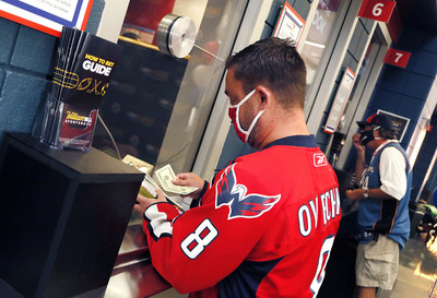 William Hill Officially Opened its First-Ever Sports Book Within a U.S. Sports Complex at Capital One Arena in Washington, D.C. Today's Grand Opening Celebration Featured Ceremonial First Bets Placed by Season Ticket Holders Loyal to the Washington Capitals, Wizards and Mystics Since Their Inaugural Seasons. Dave Feldman of Ellicott City, Md. bet $46 (the number of years his family has been season ticket holders) on the Washington Capitals bringing back the Stanley Cup this year.