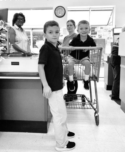 Amanda Stelly and her two sons shop at the grocery in Arnaudville, Louisiana. Stelly is a hardworking mother and ALICE. (photo taken in January 2019.)