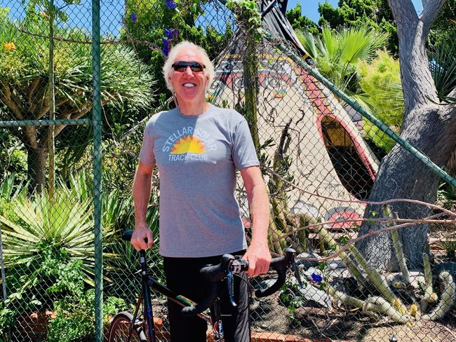 Stellar Solar solar evangelist Bill Walton sporting his Stellar Solar Track Club shirt at his solar powered home in San Diego.