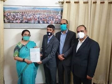 Optum contribution of ₹4,65,18,775 to the Prime Minister's CARES Fund Photo shows (from left to right) Ms. Meenakshi Lekhi, Hon. Member of Parliament, Mr. Sameer Bansal, Vice President, Optum Global Solutions, Mr. Vivek Kler Associate General Counsel, Optum Global Solutions and Mr. Puneet Sawhney, Senior Director, Marketing and Market Intelligence, Optum Global Solutions