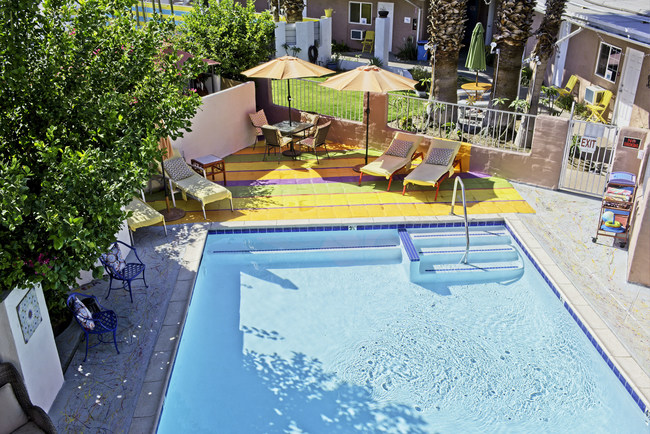 A birds-eye view of the pool at Inn at Palm Springs gives viewers a glimpse of the vibrant colors inspired by the cheerful spirit surrounding the property, staff, and guests who visit.