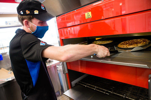 Domino's corporate and franchise stores are looking to fill more than 20,000 positions, including delivery experts, pizza makers, customer service representatives, managers, and assistant managers.