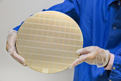 """A collection of IBM POWER10 7nm processors on a silicon wafer. The wafer is cut into individual chips that become the """"brains"""" behind IBM Power Systems servers. Each IBM POWER10 chip can deliver up to 3x the capacity and energy efficiency of the previous generation and up to 20x faster INT8 AI inferencing. Credit: Connie Zhou for IBM"""