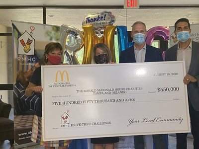 Franchisees Chris Frost and Javier Illas present a $550,000 check to Lisa Suprenand, Executive Director of RMHC Tampa and Lou Ann DeVoogd, President and CEO of RMHC Central Florida.