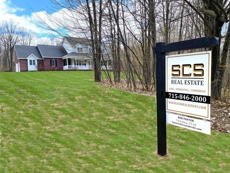 SCS Real Estate sign