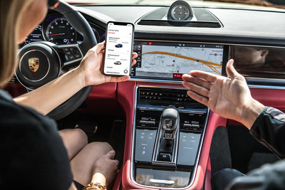 Customer explores the Porsche Drive app. Since the pandemic, social distancing and other safety measures have been put in place during vehicle flips.