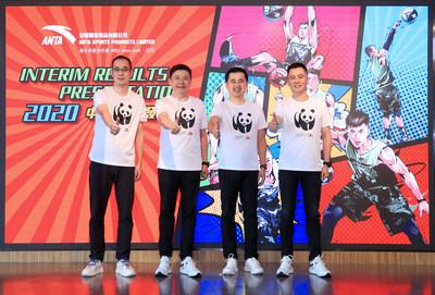 Anta Group Executives wearing commemorative T-shirt themed Anta Group and WWF cooperation