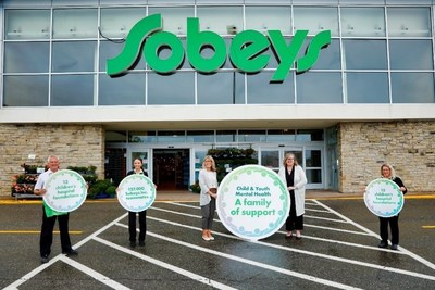 "Heather Sobey-Connors, Chair, Sobey Family Council and Trustee, The Sobey Foundation, Jennifer Gillivan, President and CEO, IWK Foundation and Board Chair, Canada's Children's Hospital Foundations (centred, left to right) and Sobeys Inc. teammates celebrate the launch of groundbreaking partnership, ""A Family of Support"" Child and Youth Mental Health Initiative, at Sobeys Aberdeen in Halifax, NS. (CNW Group/Sobeys Inc.)"