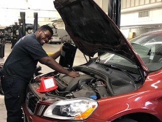 Universal Technical Institute and Volvo SAFE Graduate Kendrick Cowart at his new job at Rickenbaugh Volvo in Denver, Colorado. Cowart graduated from the automotive program at UTI's Lisle, Illinois campus before being recruited for the manufacturer-paid Volvo SAFE program.