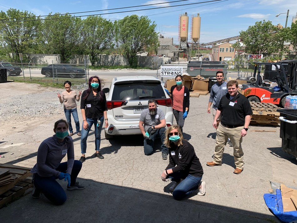 Mitsubishi Motors North America volunteers pose after volunteering with the Community Resource Center Nashville.
