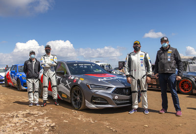 The Acura race team celebrates at the 14,115 foot summit of Pikes Peak