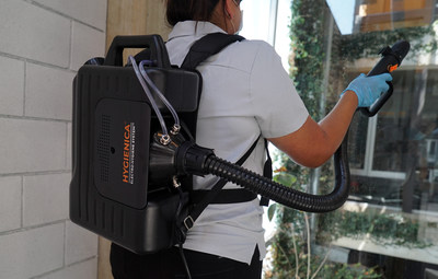 A facility worker sanitizes and disinfects an office space using the latest technology from HYGIENICA. The HX Pro Plus offers the most sophisticated antiviral disinfecting technology available on the market.