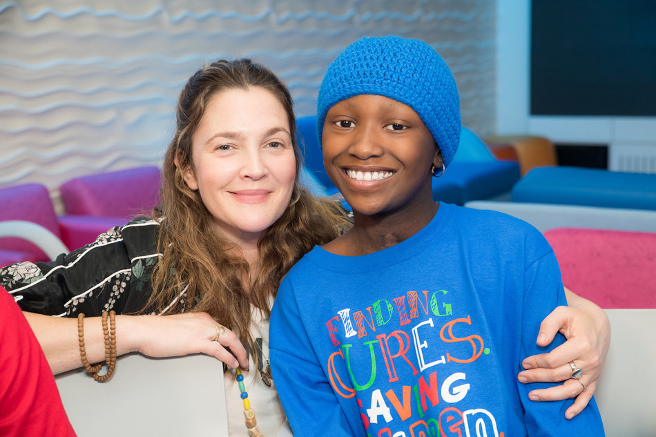 Actress Drew Barrymore (left) and St. Jude patient Damaya (right) hang out at St. Jude Children's Research Hospital in 2017. The St. Jude Celebrity Ambassador is helping kick off the first week of the 30 Days #forStJude campaign.
