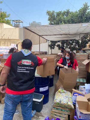 Volunteers organized by Ziyad Brothers Importing distribute food in Beirut, Lebanon to the victims of the August 4, 2020 explosion. Photo courtesy Ziyad Brothers Importing.