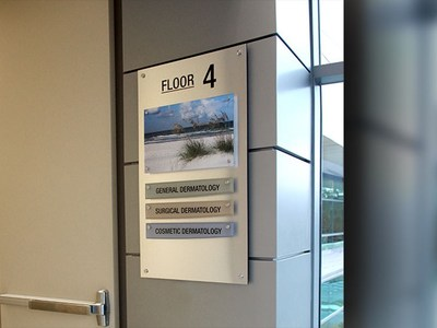 """ID Signsystems employs """"layered"""" modular systems when frequent changes need to be made that combine temporary and permanent information. This changes connection detailing based on changeability."""