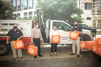 Representatives from Suburban Propane including Bill Hassard and Jesse Moore along with representatives from Whataburger deliver over 850 complete meals to healthcare staff at Houston Methodist Hospital on Wednesday, September 2, 2020.