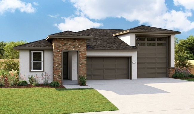 The Bronze plan with attached RV garage is one of three new model homes at Richmond American's Seasons at Thoroughbred Acres community in Olivehurst, CA.