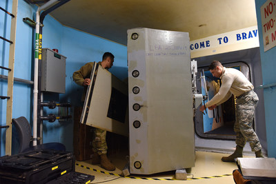 Airmen service a reinforced door at a U.S. missile alert facility. The facilities would be upgraded or replaced as part of the Ground Based Strategic Deterrent program. (U.S. Air Force photo)