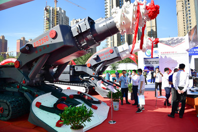 Visitors to the exhibition watching a heading machine from an exhibitor at the Coal Expo on September 8.