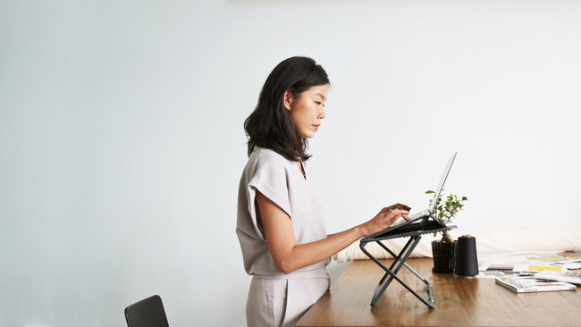 The world's first 2-in-1 portable standing desk and laptop case.