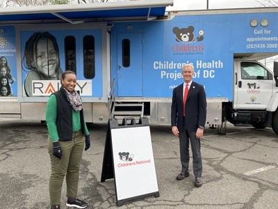 Kevin Reilly, Board Member of Hyundai Hope On Wheels and President of Alexandria Hyundai, speaks with staff member at the Children's National COVID-19 testing center in Washington, D.C