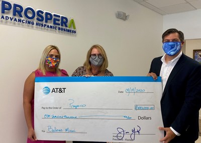 AT&T Florida Director of Corporate External and Legislative Affairs Alex Dominguez and AT&T Regional Director of External and Legislative Affairs Thais Asper present Believe Miami Donation to Prospera South Florida Vice President Myrna Sonora