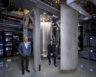 "IBM Chief Executive Officer Arvind Krishna (left) and Director of IBM Research Dario Gil are pictured with a 10-foot-tall and 6-foot-wide ""super-fridge,"" a dilution refrigerator larger than any commercially available. The ""super-fridge"" is being custom built by IBM to effectively support quantum systems as they scale to the thousands and eventually million-plus qubit systems of the future that will be capable of solving problems out of reach of today's most powerful supercomputers. Credit: Connie Zhou for IBM."