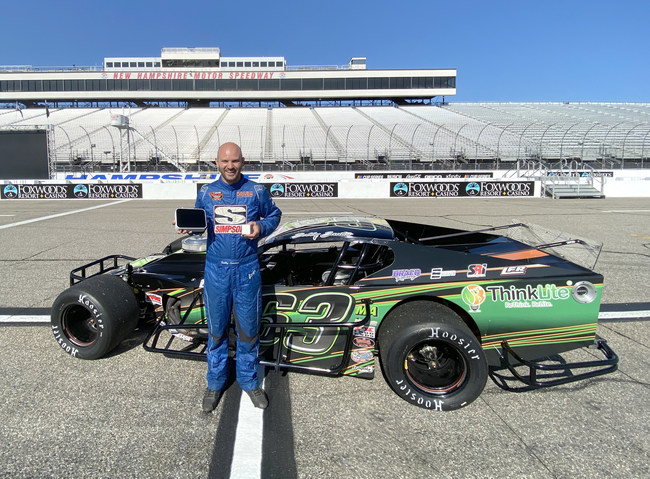Bobby poses with the ThinkLite Flair Monitor in front of his winning car. (PRNewsfoto/ThinkLite)