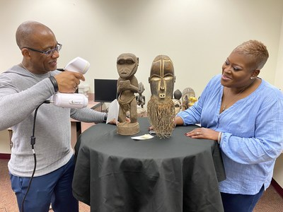 Dr. Bryan Carter of the University of Arizona and Broward County Library Community Engagement Manager Dr. Roslyn Dean scan an artifact for Virtual AARLCC.