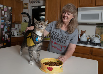 Purina Cat Chow is donating $30,000 to Pet Partners to encourage the training and registration of therapy cat teams like Tommy the blind cat and his owner Christy.