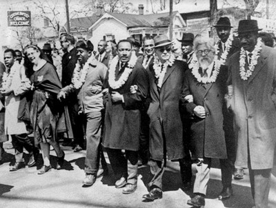 Rabbi Heschel walking arm-in-arm with Dr. Martin Luther King in Selma